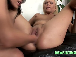 Oiled lesbians love being fisted slowly