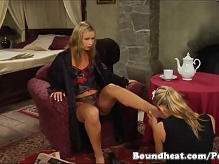 Lesbian slave cleaning mistresses feet