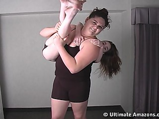 Nadia carries Jssica and spanks her