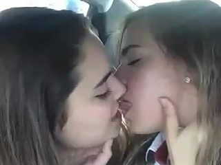 2 horny girls kissing in the car