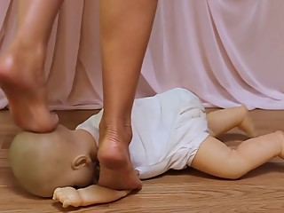 Baby Doll Trampled under beautiful Bare Feet